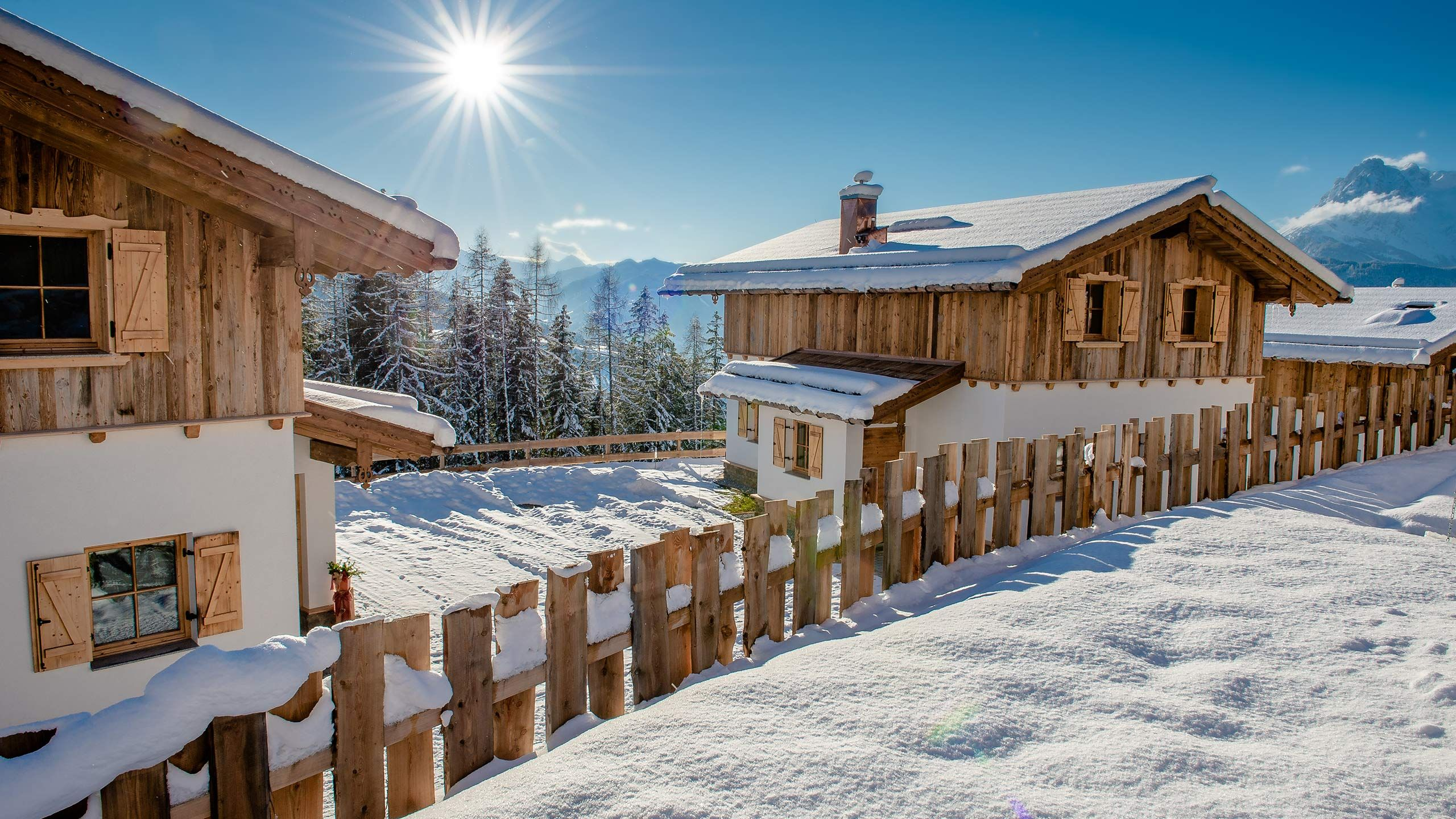 View of two Eulersberg chalets. Winter atmosphere, sun is shining.